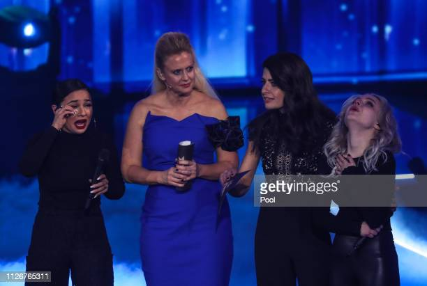 The duo Ssters react next to hosts Barbara Schoeneberger and Linda Zervakis after winning the show Unser Lied fuer Israel at Studio Berlin Adlershof...