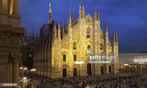the duomo di milano, milan's magnificent gothic cathedral, at twilight. milan, italy - duomo di milano stock pictures, royalty-free photos & images