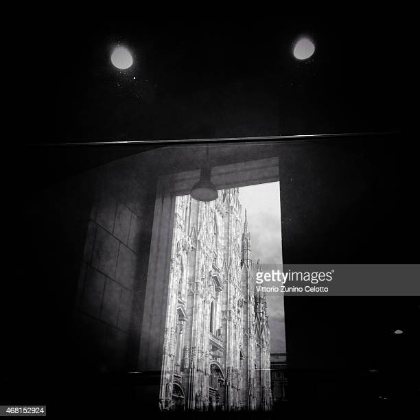 The Duomo is reflected on a window on March 30 2015 in Milan Italy Milan was named as the 2015 Universal Exposition hosting city It will run from May...