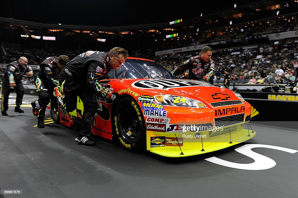The #24 DuPont Chevrolet pit crew race during the NASCAR Sprint Pit Crew Challenge at Time Warner Cable Arena on May 19, 2010 in Charlotte, North Carolina.