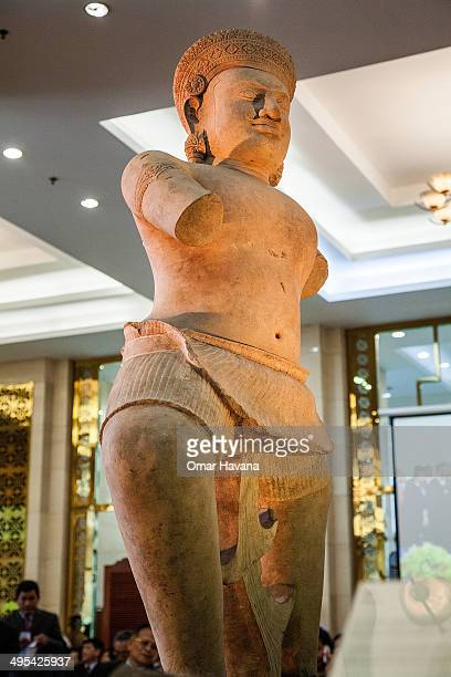 The Duryodhama statue is displayed during a ceremony to handover three statues back to Cambodia at the Council of Ministers on June 3 2014 in Phnom...