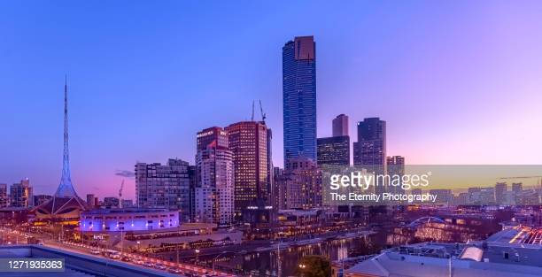 the dusk colors over melbourne southbank at sunset - melbourne australia stock pictures, royalty-free photos & images
