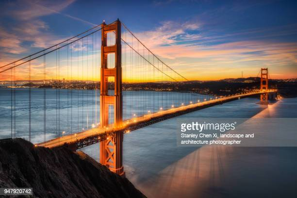 the dusk of golden gate bridge - san francisco california stock photos and pictures