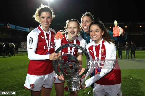 The Dutch Arsenal players Dominique Janssen Vivianne Miedema goalkeeper Sari Van Veenendaal and Danielle Van De Donk pose with the trophy during the...