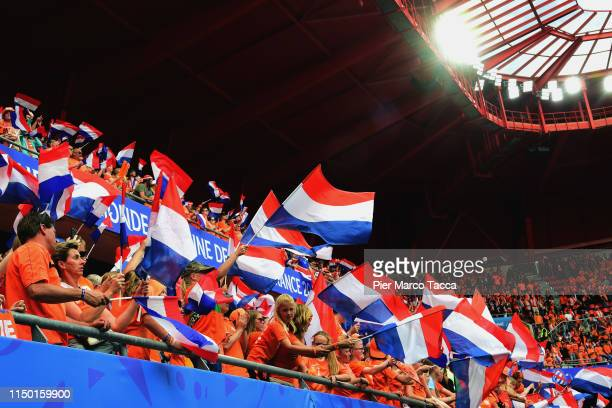 The Dutch fans wave the flags during the 2019 FIFA Women's World Cup France group E match between Netherlands and Cameroon at Stade du Hainaut on...