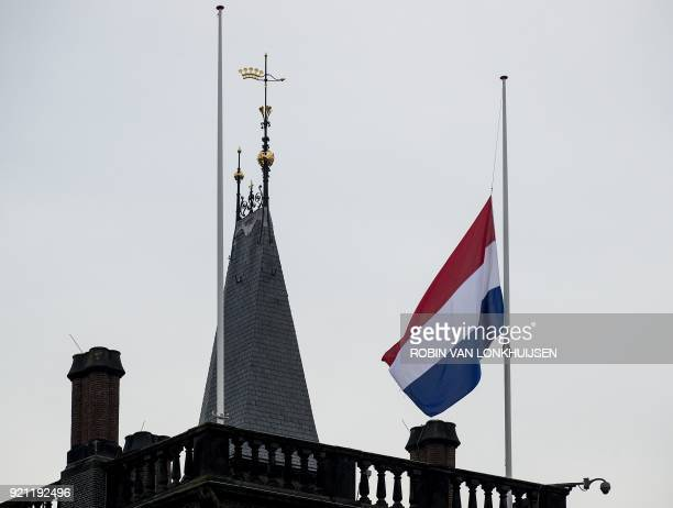 The Dutch flag flies half mast at the Binnenhof in The Hague on February 20 during the funeral of the former Dutch Prime Minister Ruud Lubbers The...