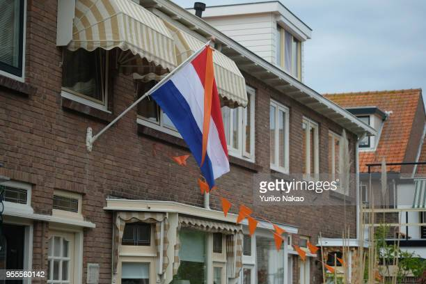The Dutch national flag is put up outside a house to celebrate the Koningsdag or the King's day April 27 in Katwijk, Netherlands. King's day is a...