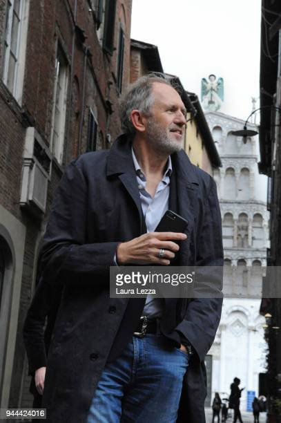 The Dutch photographer film director music video director and visual artist Anton Corbijn leaves after attending a discussion on cinema at the Lucca...