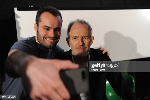 The Dutch photographer film director music video director and visual artist Anton Corbijn poses for a photo with his fans after attending a...