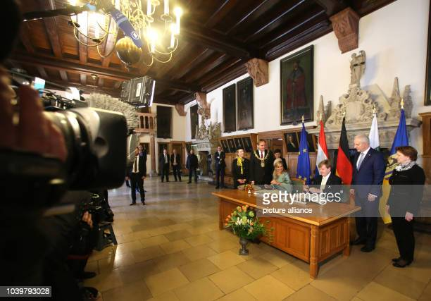 The Dutch royal couple WillemAlexander and Maxima write an entry in the city guest book in the OldTown Hall in Leipzig Germany 09 February 2017...