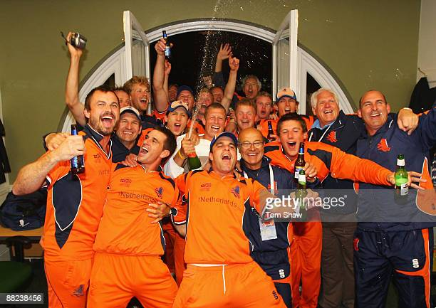 The Dutch team celebrate in the changing room after the ICC World Twenty20 Group B match between England and the Netherlands at Lord's on June 5,...