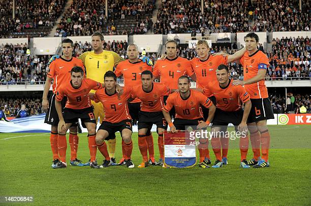 The Dutch team poses ahead of their Euro 2012 Group E qualifying football match Finland vs the Netherlands at the Olympic Stadium in Helsinki Finland...