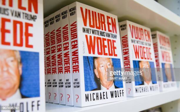 The Dutch translation of Michael Wolff's book 'Fire and Fury' about US President Donald Trump is laid out for sale at a bookstore in The Hague The...