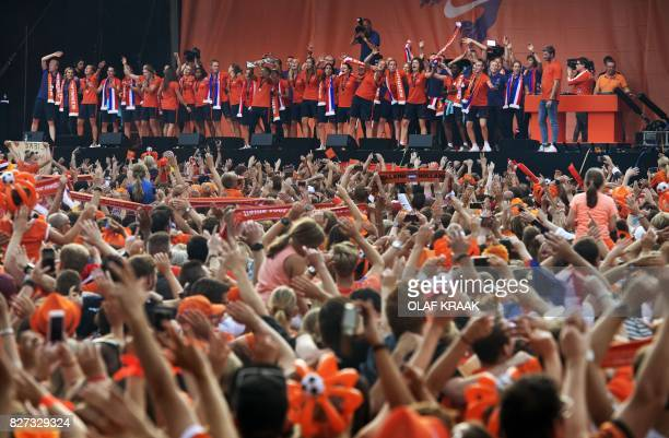 The Dutch women's soccer team celebrate on stage during the honor ceremony in Utrecht on August 7 after winning the UEFA Women's Euro 2017 final...