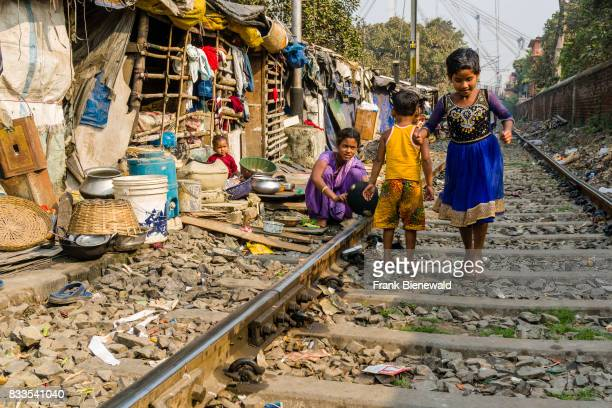 The dwellings and huts in China Bazar slum area are located right next to the railroad tracks children are playing in front of their huts