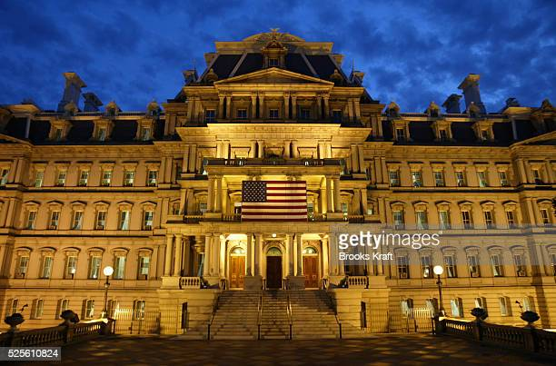 The Dwight D Eisenhower Executive Office Building also known simply as the Old Executive Office Building is illuminated as evening falls in...