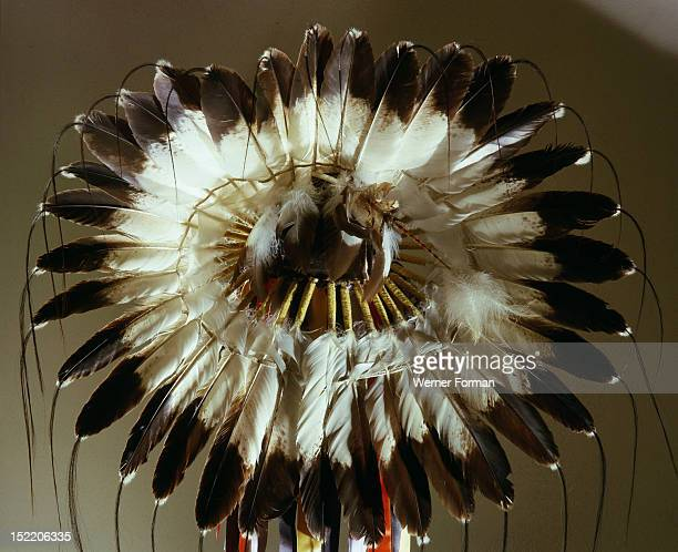 The eagle feather war bonnet symbol of the outstanding warrior and a source of spiritual power and inspiration utilized an ingenious method of...