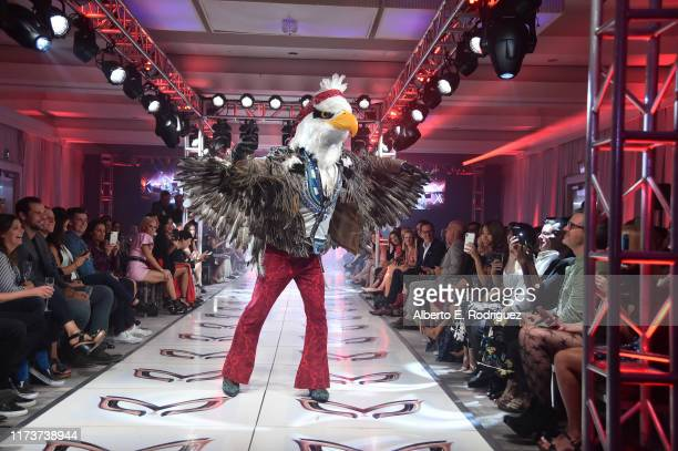The Eagle participates in a runway show for the premiere of Fox's The Masked Singer Season 2 at The Bazaar at the SLS Hotel Beverly Hills on...