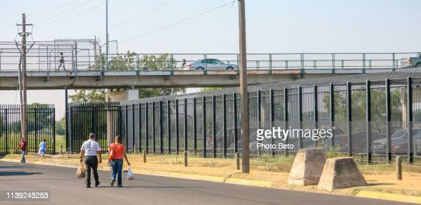 usa/mexico border - eagle pass texas - immigrants crossing sign stock photos and pictures