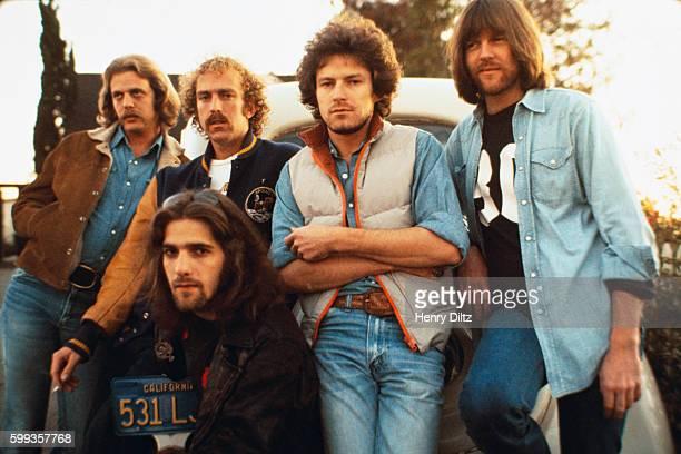 The Eagles are standing left to right Don Felder Bernie Leadon Don Henley and Randy Meisner with guitarist Glenn Frey kneeling