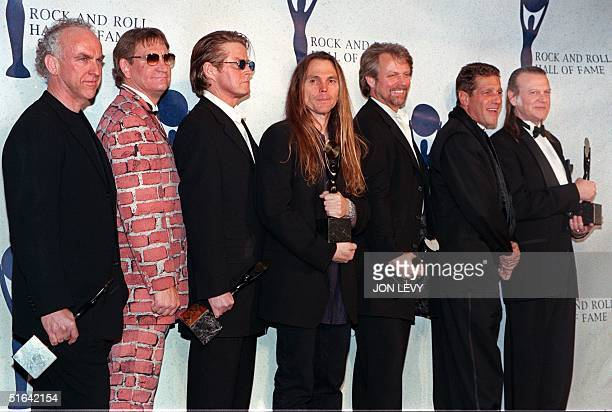 The Eagles Bernie Leadon, Joe Walsh, Don Henley, Timothy Schmit, Don Felder, and Randy Meisner appear together after receiving their awards and being...