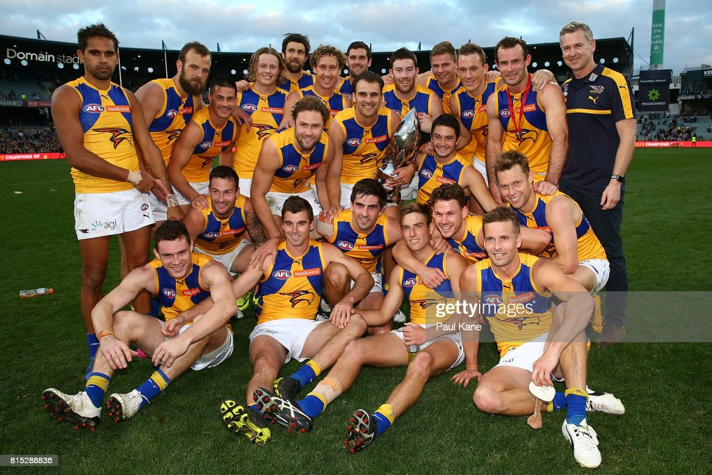 The Eagles celebrate with the Western Derby trophy after winning the round 17 AFL match between the Fremantle Dockers and the West Coast Eagles at Domain Stadium on July 16, 2017 in Perth, Australia.