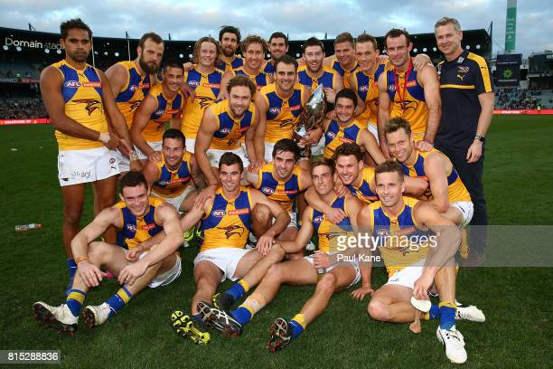 The Eagles celebrate with the Western Derby trophy after winning the round 17 AFL match between the Fremantle Dockers and the West Coast Eagles at...