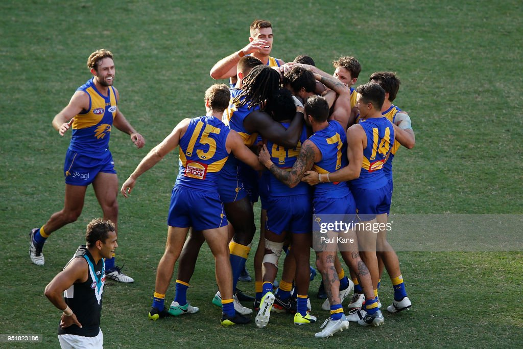 The Eagles get around Jack Petruccelle after kicking a goal during the round seven AFL match between the West Coast Eagles and the Port Adelaide Power at Optus Stadium on May 5, 2018 in Perth, Australia.