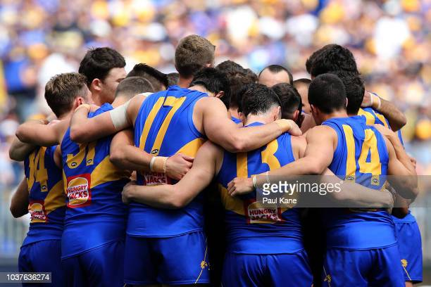 The Eagles huddle before the start of the game during the AFL Prelimary Final match between the West Coast Eagles and the Melbourne Demons on...