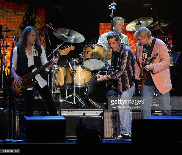 The Eagles performing at Wembley Arena in London 18th June 2006 Left to right Timothy B Schmit Glenn Frey Joe Walsh and on drums Don Henley