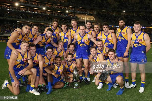 The Eagles pose with the RAC Derby trophy after winning the round four AFL match between the West Coast Eagles and the Fremantle Dockers at Optus...