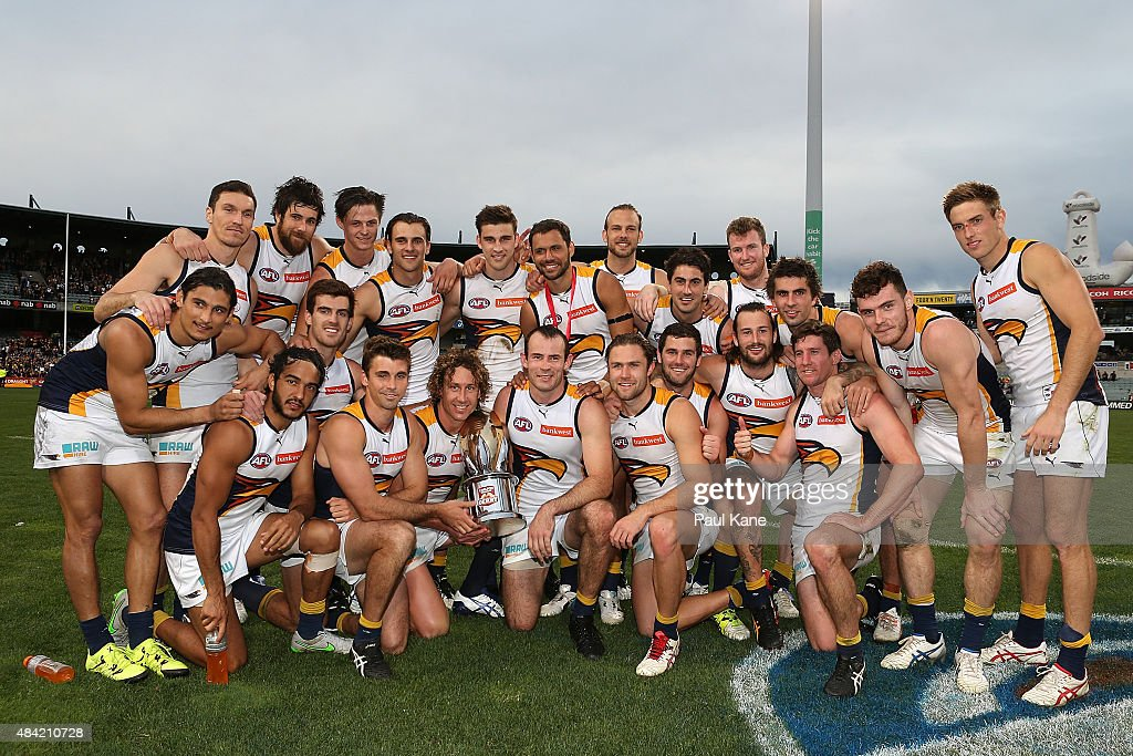 The Eagles pose with the Western Derby trophy after winning the round 20 AFL match between the Fremantle Dockers and the West Coast Eagles at Domain Stadium on August 16, 2015 in Perth, Australia.
