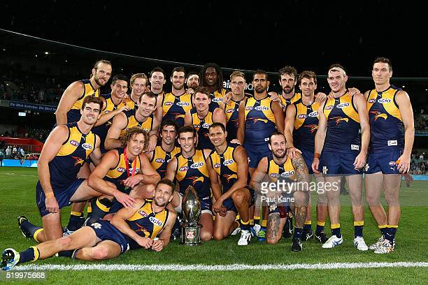The Eagles pose with the Western Derby trophy after winning the round three AFL match between the West Coast Eagles and the Fremantle Dockers at...