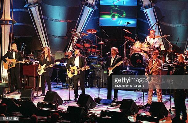 The Eagles Randy Meisner Timothy Schmit Glenn Frey Don Felder Joe Walsh Don Henley and Bernie Leadon appear together on stage after receiving their...