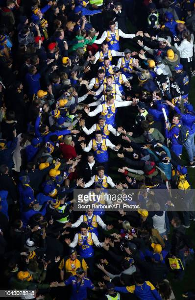 The Eagles walk through the crowd during the Virgin Post Match Premiership Party after winning the 2018 AFL Grand Final match between the Collingwood...