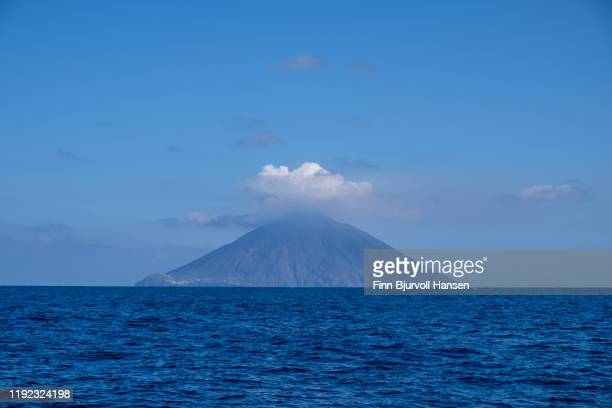 the eaolian island of stromboli prhotographed from the seaside - finn bjurvoll ストックフォトと画像