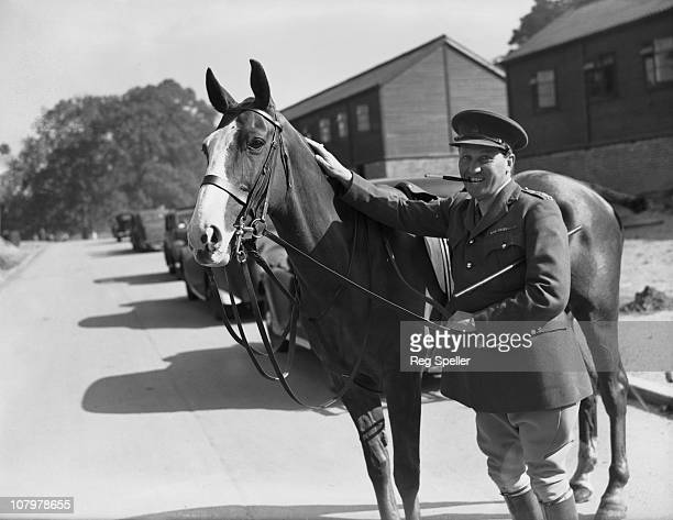The Earl of Carnarvon adjutant of a cavalry training regiment of the British Army in Maidstone Kent during World War II with his charger 1st August...
