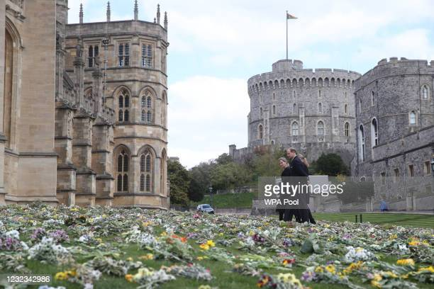 The Earl of Wessex, Lady Louise Windsor and the Countess of Wessex view flowers outside St George's Chapel, at Windsor Castle, Berkshire, following...