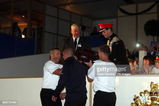 The Earl of Wessex Presents HMNB Portsmouth with the winners trophy at the Windsor Castle Tattoo after Portsmouth beat HMS Collingwood in a week long...