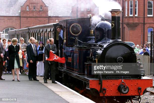 The Earl of Wessex unveiling the name plate of 116yearold recommissioned steam engine The Caledonia as he and Sophie Countess of Wessex second left...