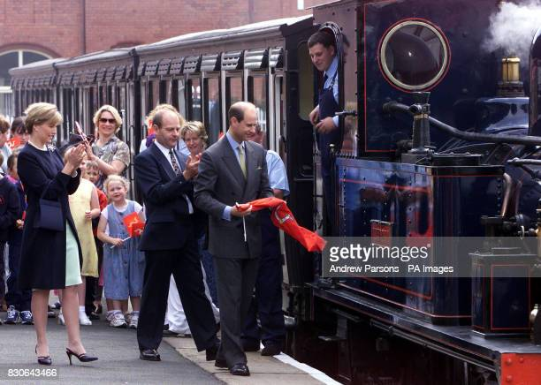 The Earl unveiling the name plate of 116yearold recommissioned steam engine The Caledonia as he and Sophie Countess of Wessex second left continued a...