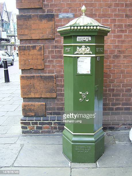 The earliest British pillar boxes were painted green, before the more familiar red colour scheme was devised. The box sits outside a museum -...
