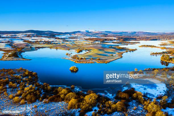 the early morning aerial view from a drone flown near calm water on a frosty morning in south west scotland - tourist stock pictures, royalty-free photos & images