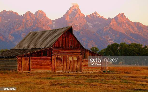 The early morning light - called alpenglow - turns the Grand Teton mountain range a particular shade of pink for a few brief seconds as the sun...