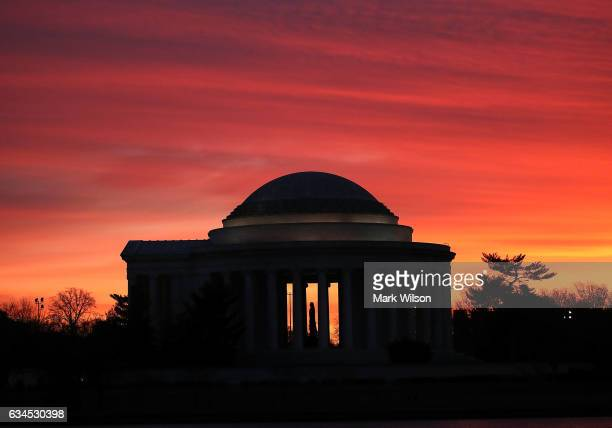 The early morning sun begins to rise behind the Jefferson Memorial on February 10 2017 in Washington DC