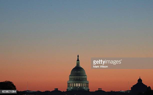 The early morning sun begins to rise behind the US Capitol on November 17 2016 in Washington DC Later today Vice Presidentelect Mike Pence is...