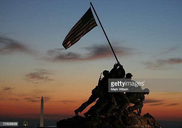 The early morning sun begins to rise behind the US Marine Corp's Iwo Jima Memorial on Veterans Day November 11 2006 in Arlington Virginia Later today...