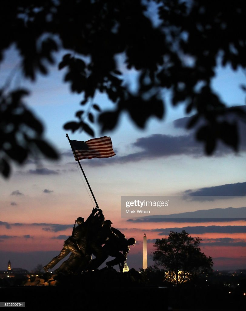 The early morning sun begins to rise behind the US Marine Corps Iwo Jima Memorial on the Corps 242nd birthday on November 10, 2017 in Arlington, Virginia.