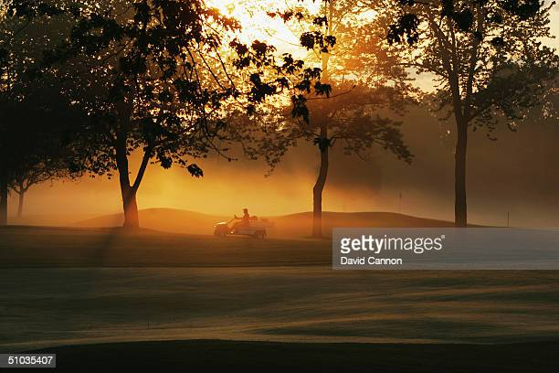The early morning sun filters through the trees beside the 7th green on the South Course at the Oakland Hills CC venue for the 2004 Ryder Cup...