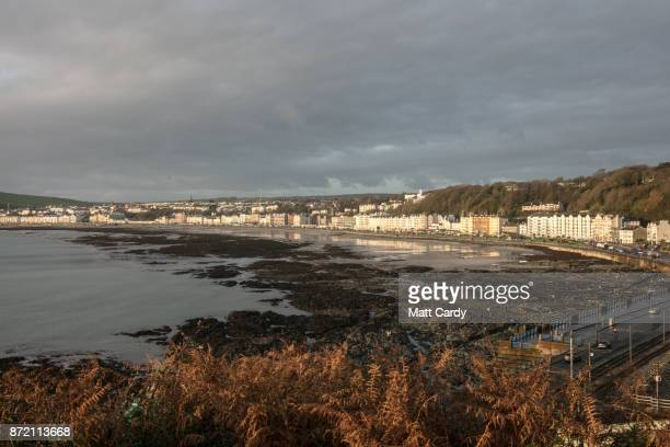 The early morning sun illuminates buildings in the town of Douglas on November 9 2017 in Douglas Isle of Man The Isle of Man is a lowtax British...